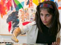 Afghani Girl Uses Prosthetic Arm To Paint & Stuns U.S Art World