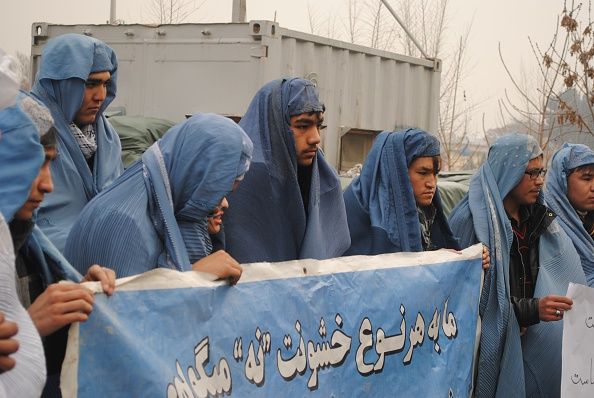 Afghan men protest violence against women