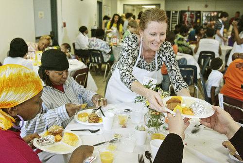 volunteer-serving-food