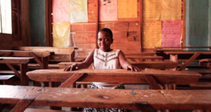 Sheilah reigns over her classroom at Valerian Nursery and Primary in Uganda. She is a member of Rhythmic Voices near the Kabalagala district of Kampala where sex workers ply their trade. By demanding universal education, the girls are disrupting the dynastic pattern of girls' following their mothers into prostitution.